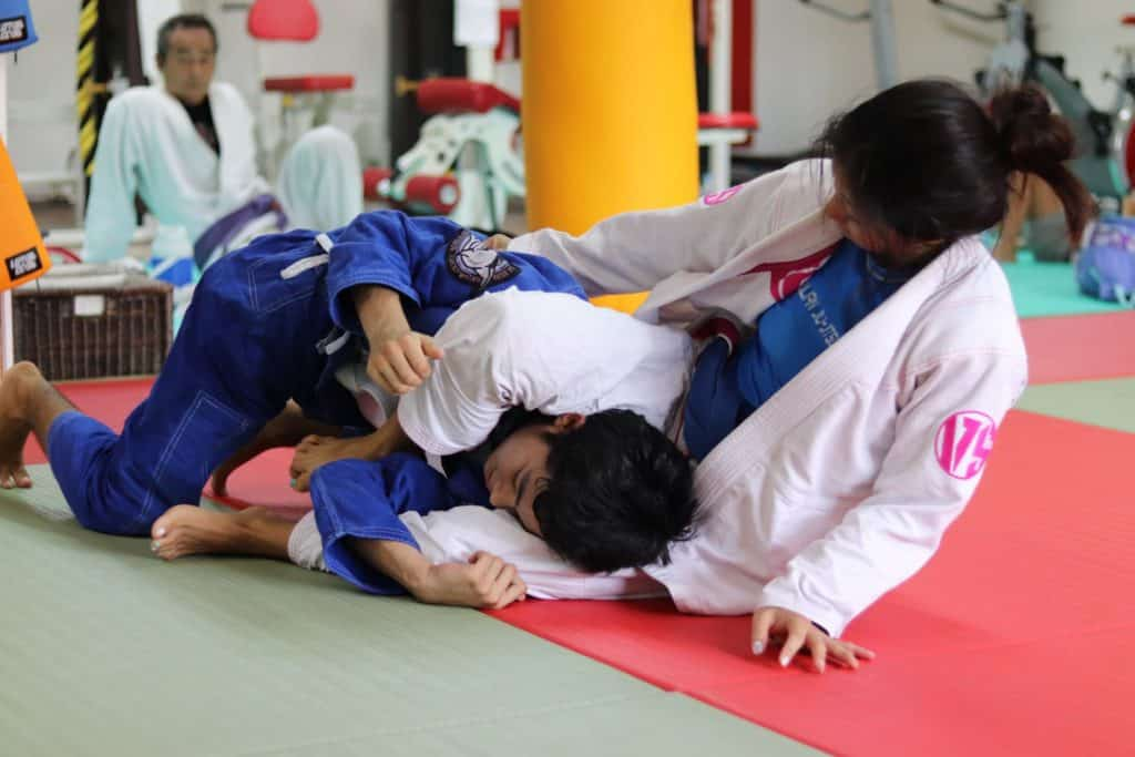 Judo et judokas en judogi de compétition